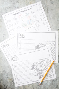 Christmas Alphabet Practice Worksheets on gray background
