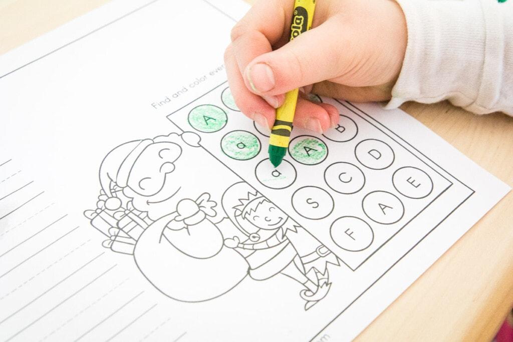 Child doing Christmas Alphabet Practice Worksheets