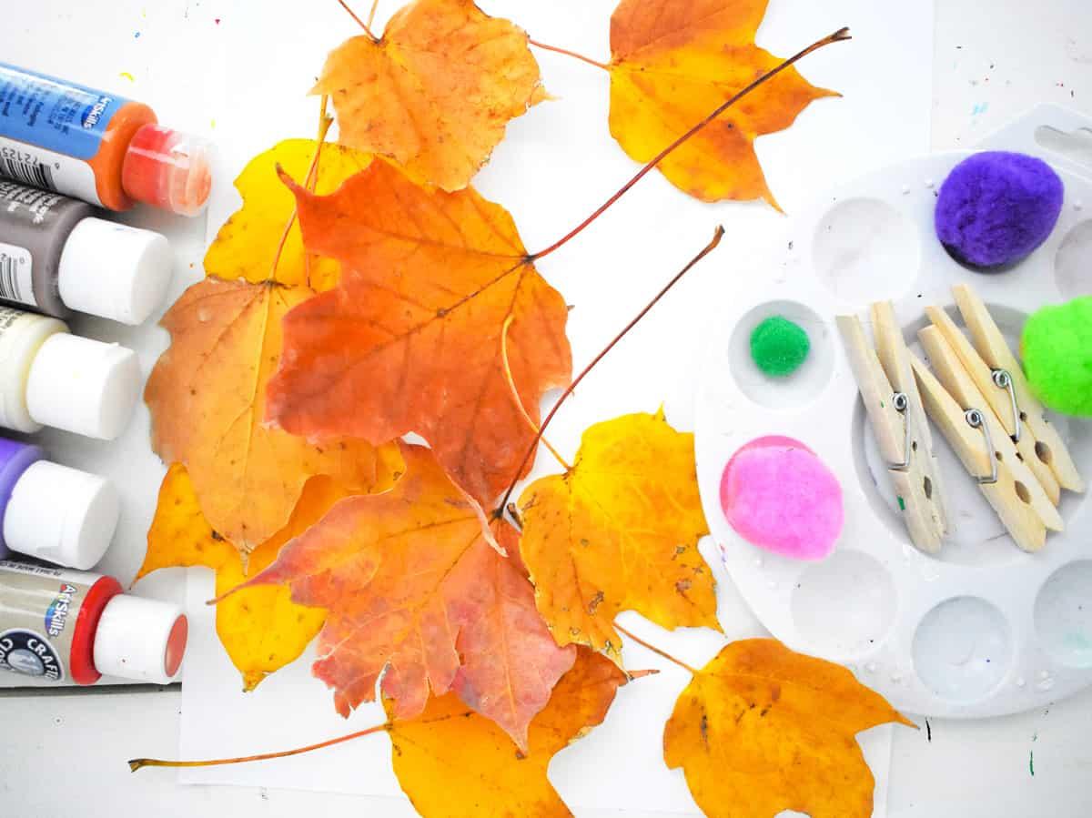 Image of supplies to do fall leaf pom pom art