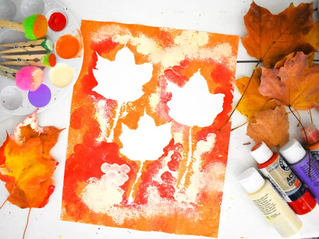 Fall Leaf Pom Pom Art with supplies laying next to it