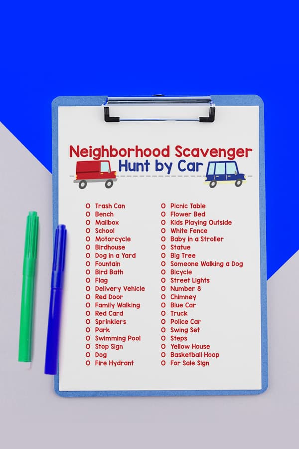 Scavenger Hunt by Car List on a clipboard and blue background