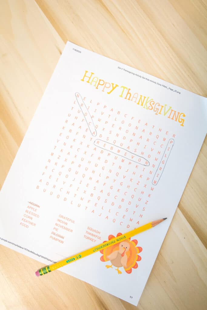 Thanksgiving Word Search Laying on a wooden desk with pencil top.