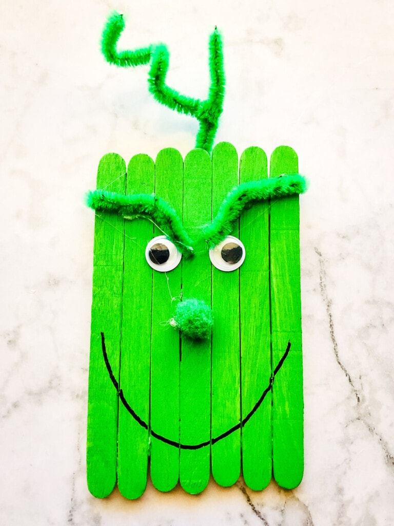 Finished green grinch popsicle stick craft