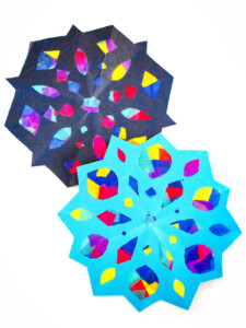 Two Snowflake Suncatchers overlapping on a white background
