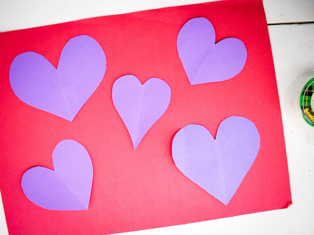 Purple heart on a red piece of paper