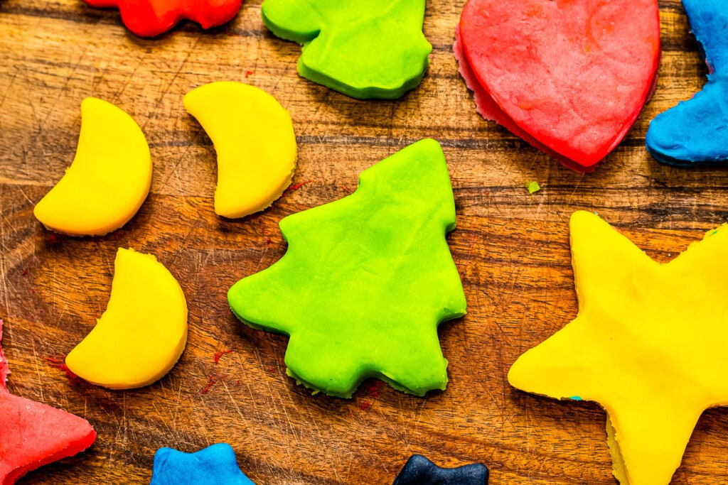Moons, christmas trees, hearts, star shapes cut out of playdough.