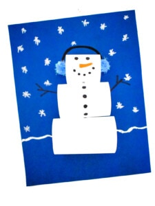 Paper Loop Snowman on blue background with snowflakes on paper