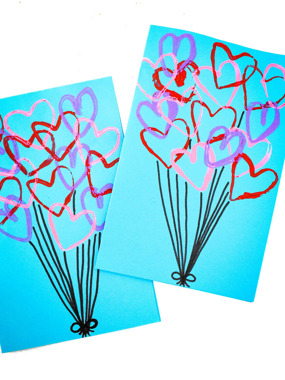 Image of two blue cards with heart stamped on them