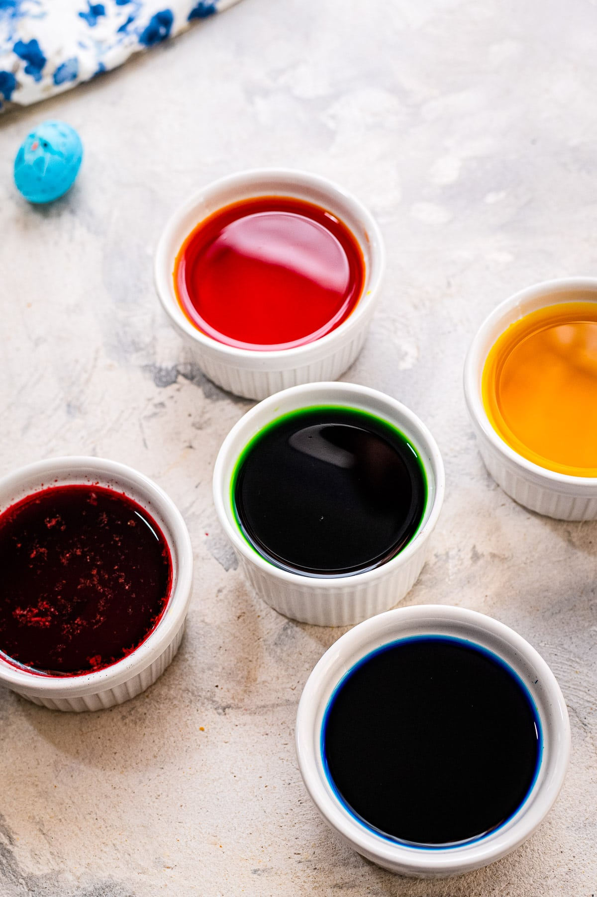 Bowls with water and dye for hard boiled eggs