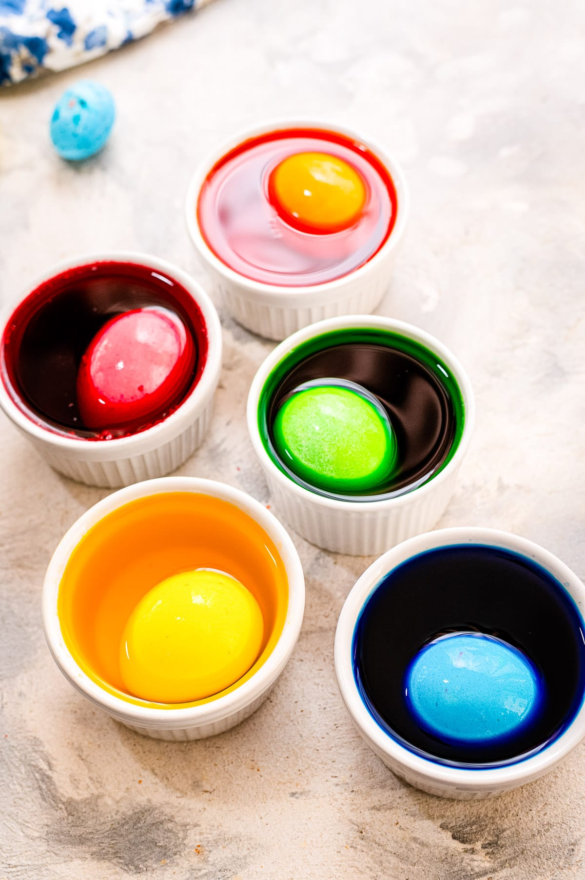 Cups with dye and hard boiled eggs in them