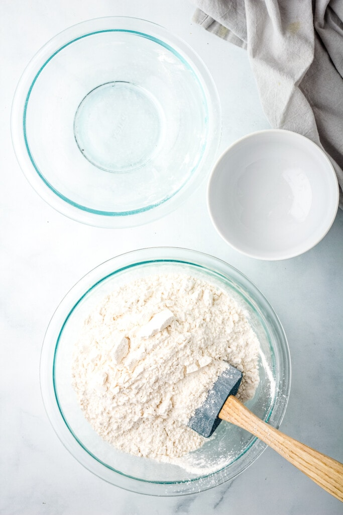 Adding flour to glass bowl for salt dough