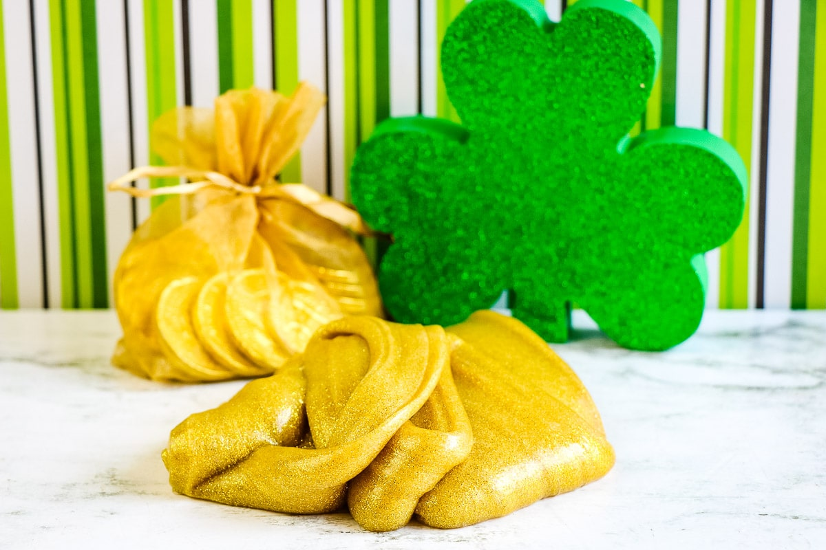 Gold slime in a pile with shamrock in background