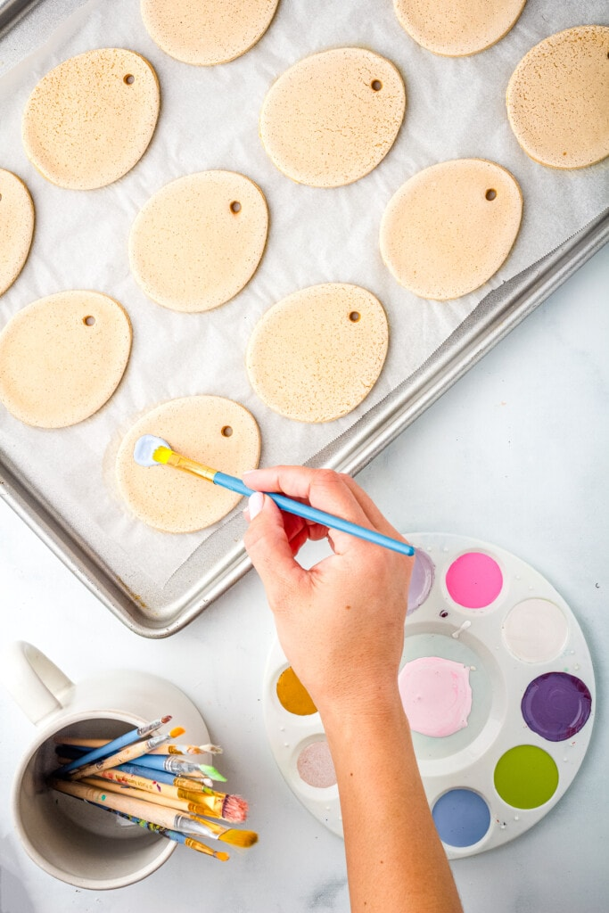 Hand painting Salt Dough Easter Eggs with paint brush