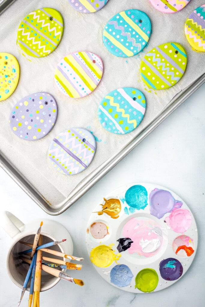 Painted Salt Dough Easter Egg Ornaments on a baking sheet