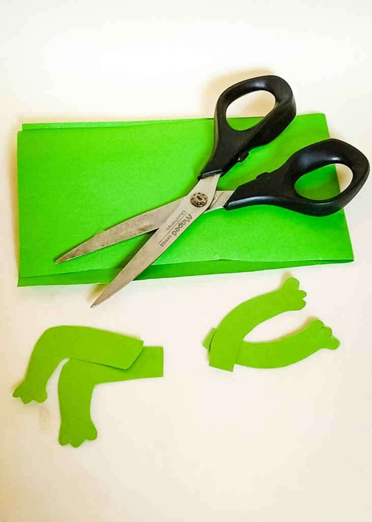 Frog and legs cut out of green paper