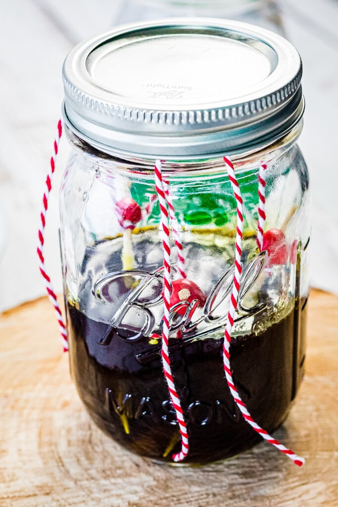 Glass jar with skewers making rock candy