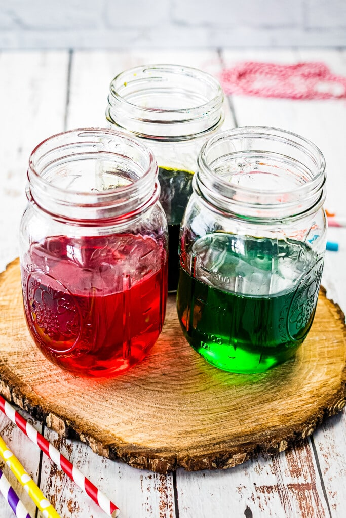 Three jars with three colors of syrup
