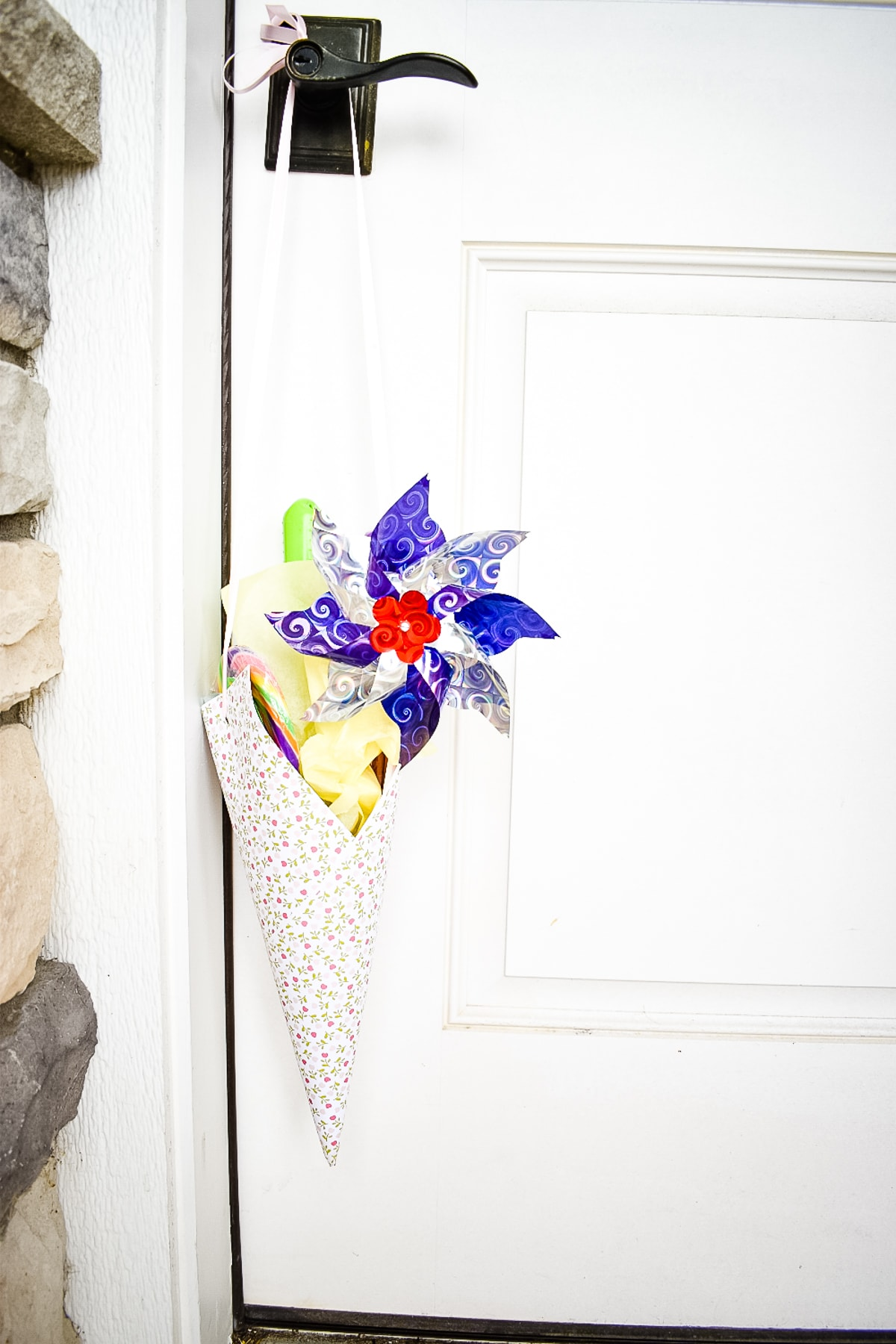 White door with May Day Basket hanging on it