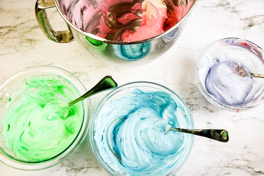 Food coloring mixed into bowls of marshmallow cream