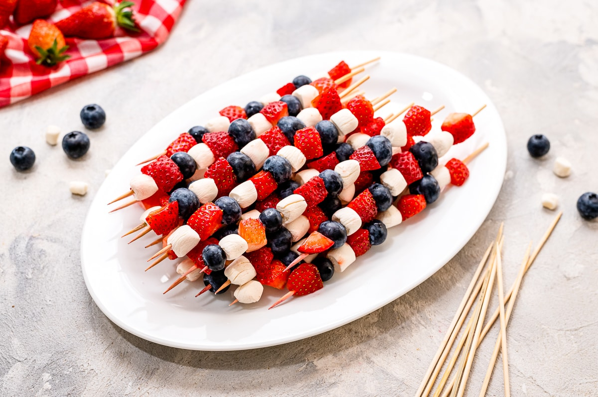 Red White and Blue Fruit Kabobs on a white platter