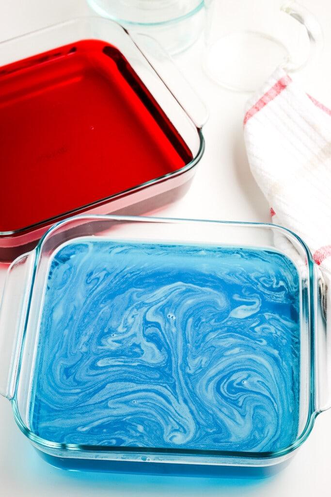 Liquid blue Jell-O jigglers in glass pan
