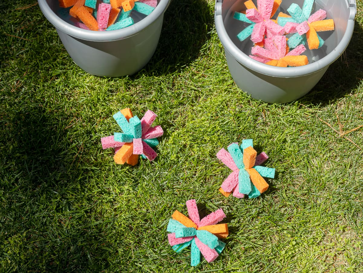 Sponge water bombs laying in the grass