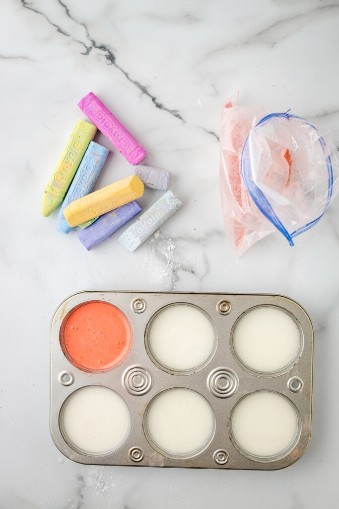 Mixed sidewalk chalk paint in muffin tin