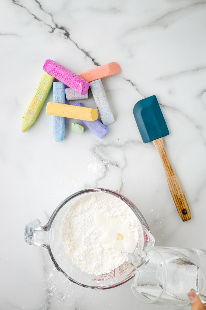 Pouring water in mixing bowl with corn starch