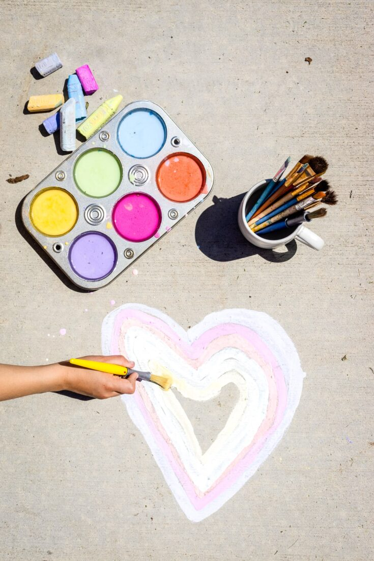 Sidewalk Chalk Paint being paint on driveway
