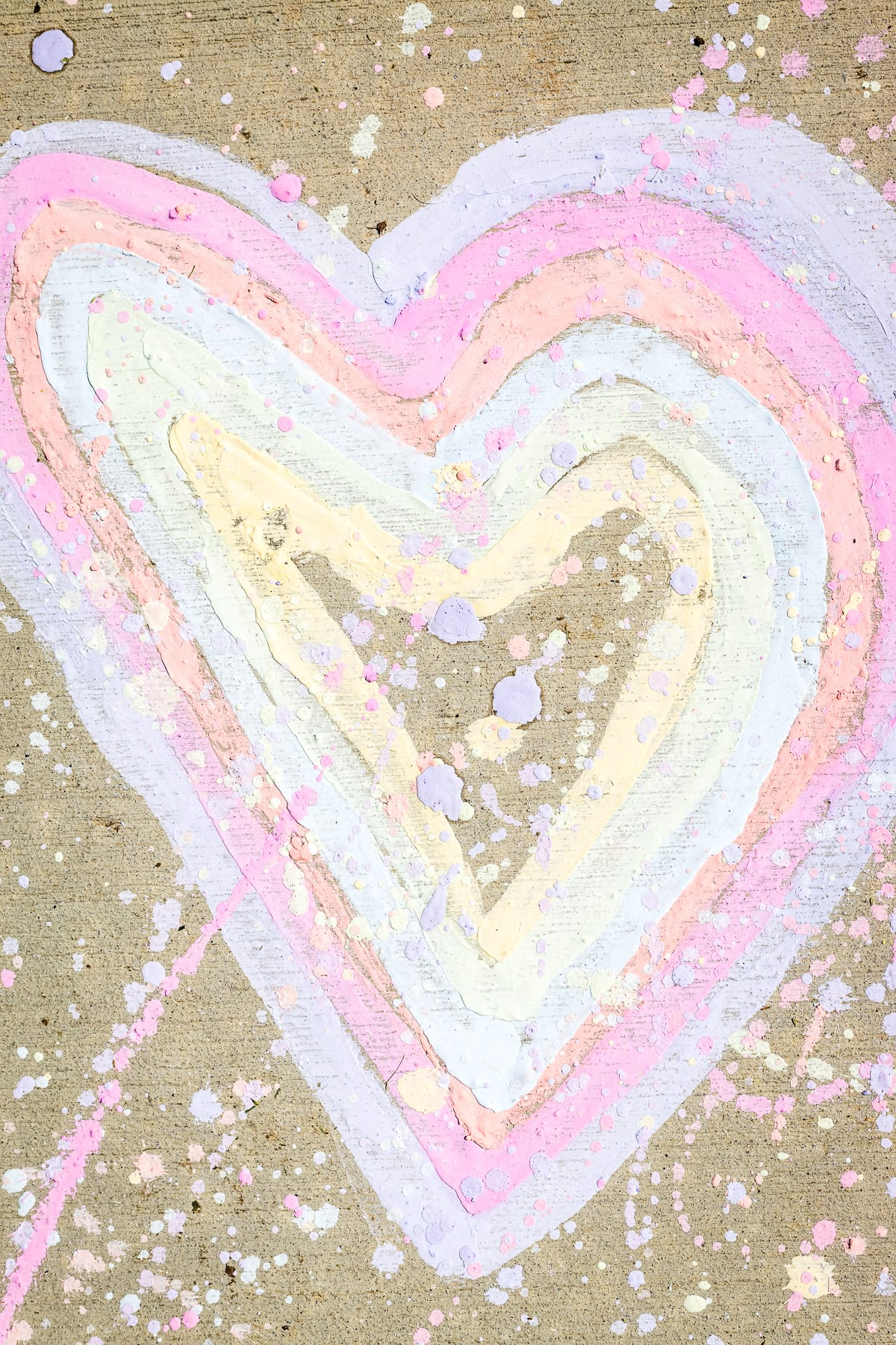 Heart made of sidewalk chalk paint with paint splatter over t