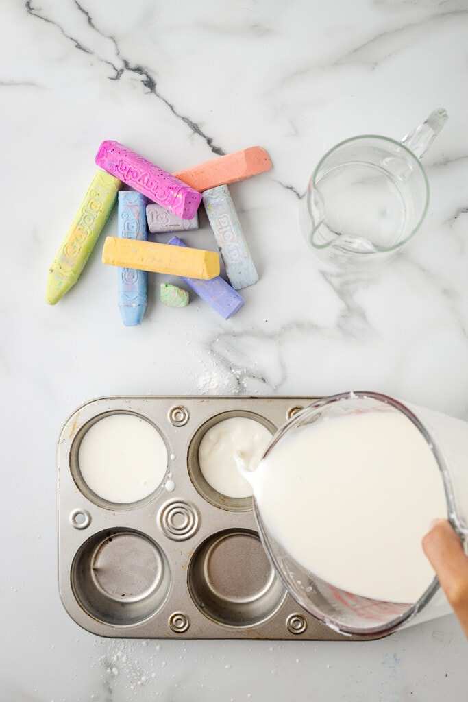 Pouring water and cornstarch mixture in muffin tins