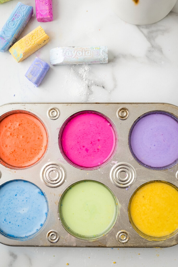 overhead image of different sidewalk chalk paints in muffin tin