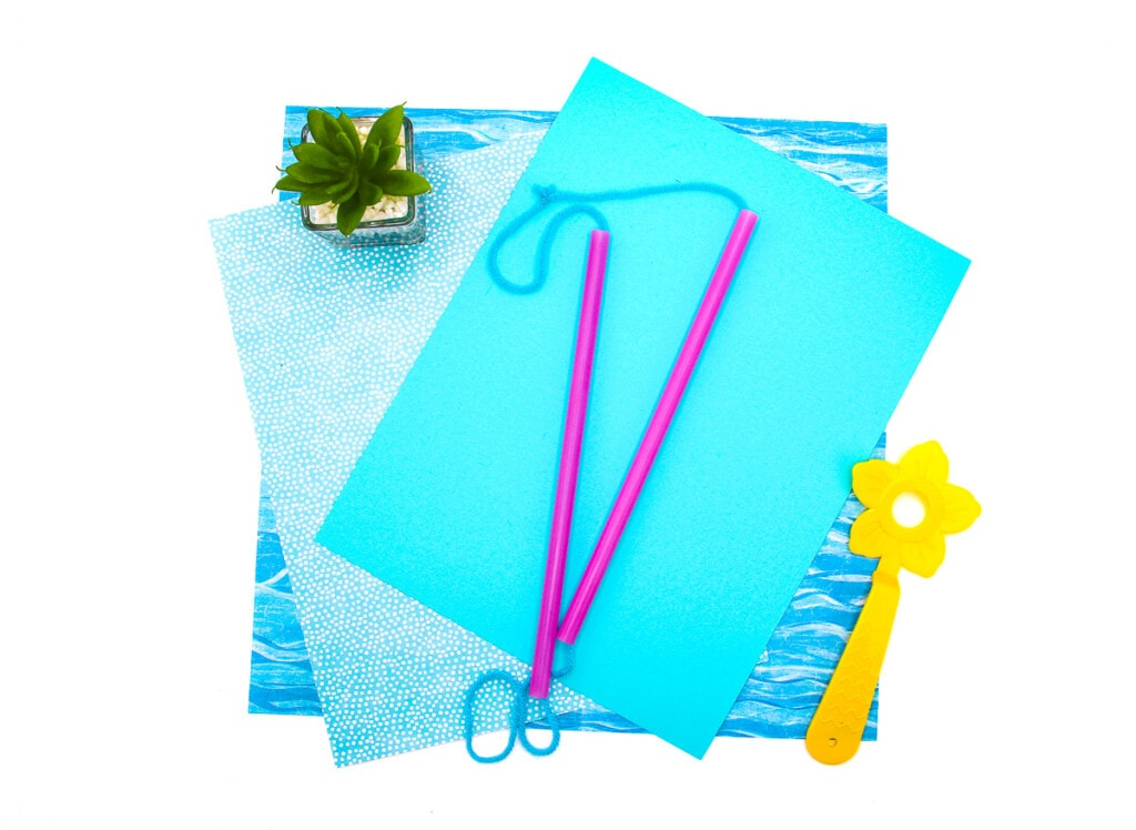 Homemade Bubble Wand on blue background