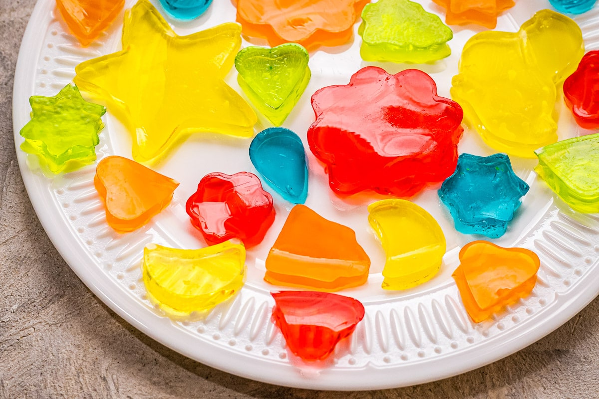 White plates with Jello Jigglers cut out in different shapes and colors
