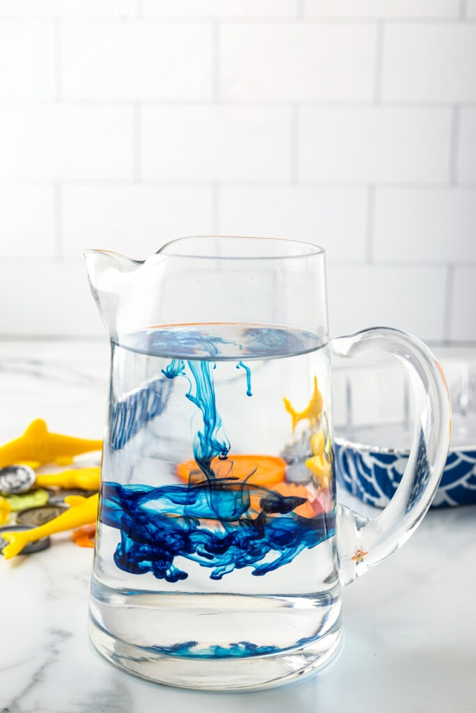 Glass pitcher with blue food coloring