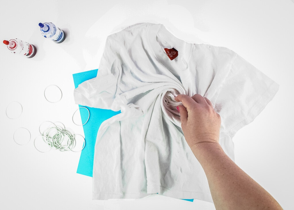 Scrunching a shirt with hand for tie dye