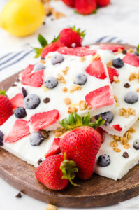 Yogurt Bark with fruit on wooden platter