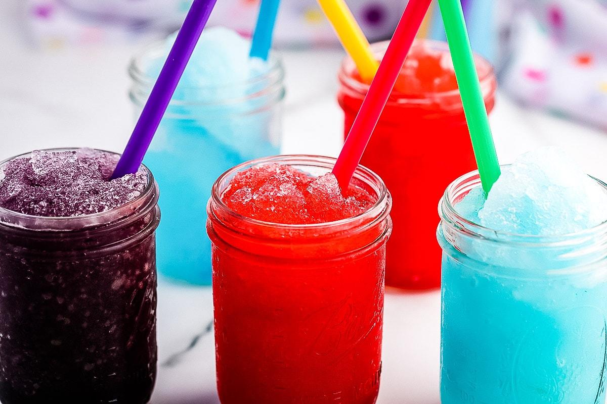 Purple, red and blue slushies in mason jars