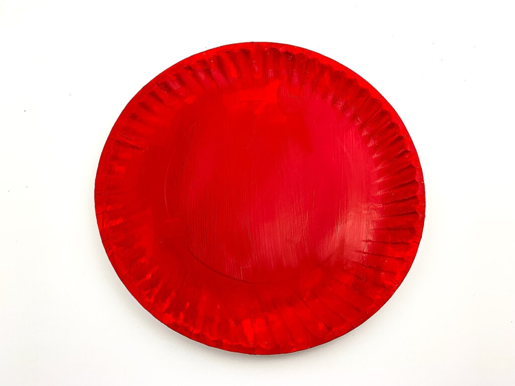 White paper plate painted red