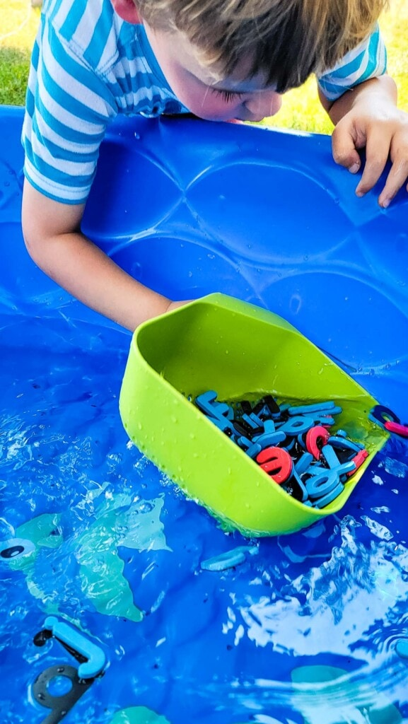 Scooping up letters out of a kiddie pool