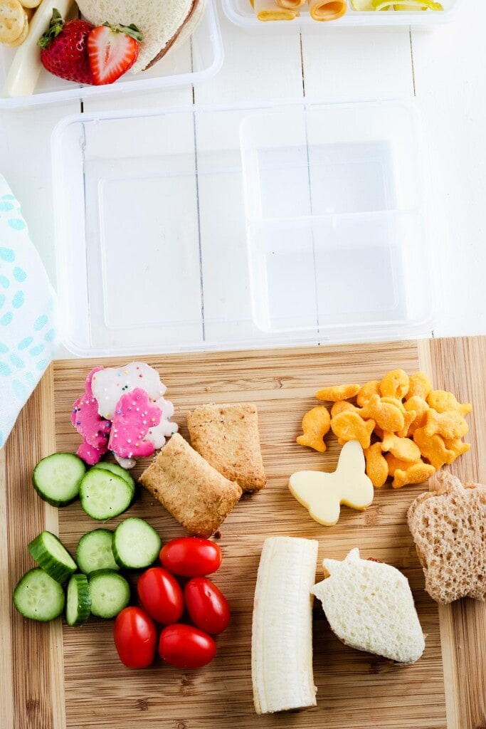 Cutting board with food for lunch boxes