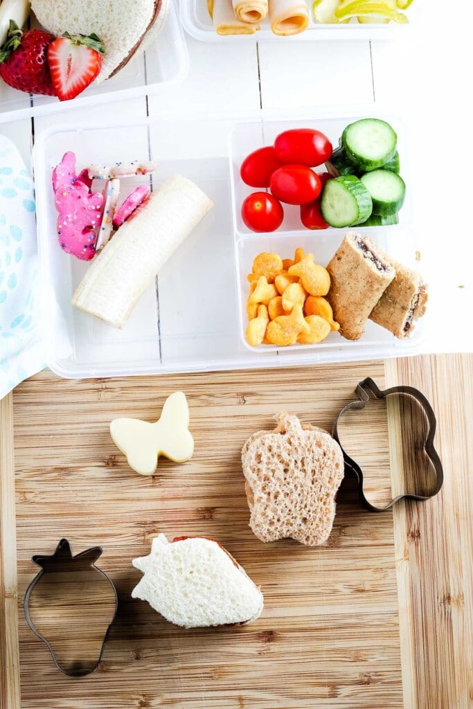Cutting board with sandwich and cookie cutter to cut it