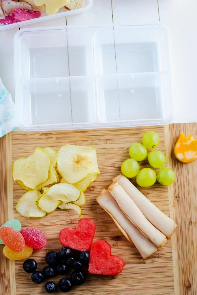 Cutting board with fruit cut into shapes