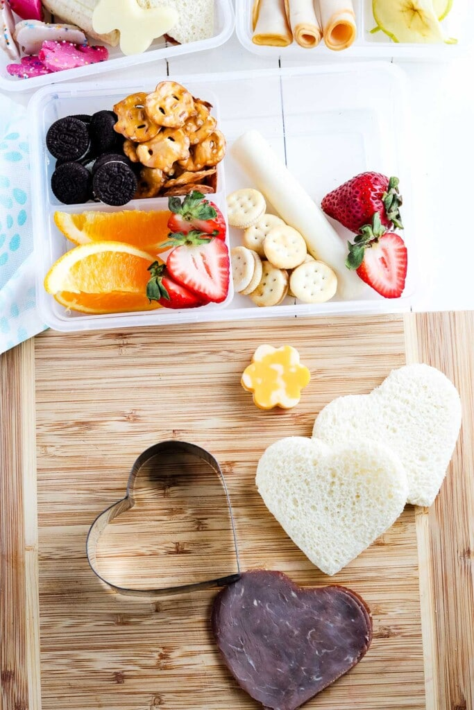 Cutting board with sandwiches cut into hearts