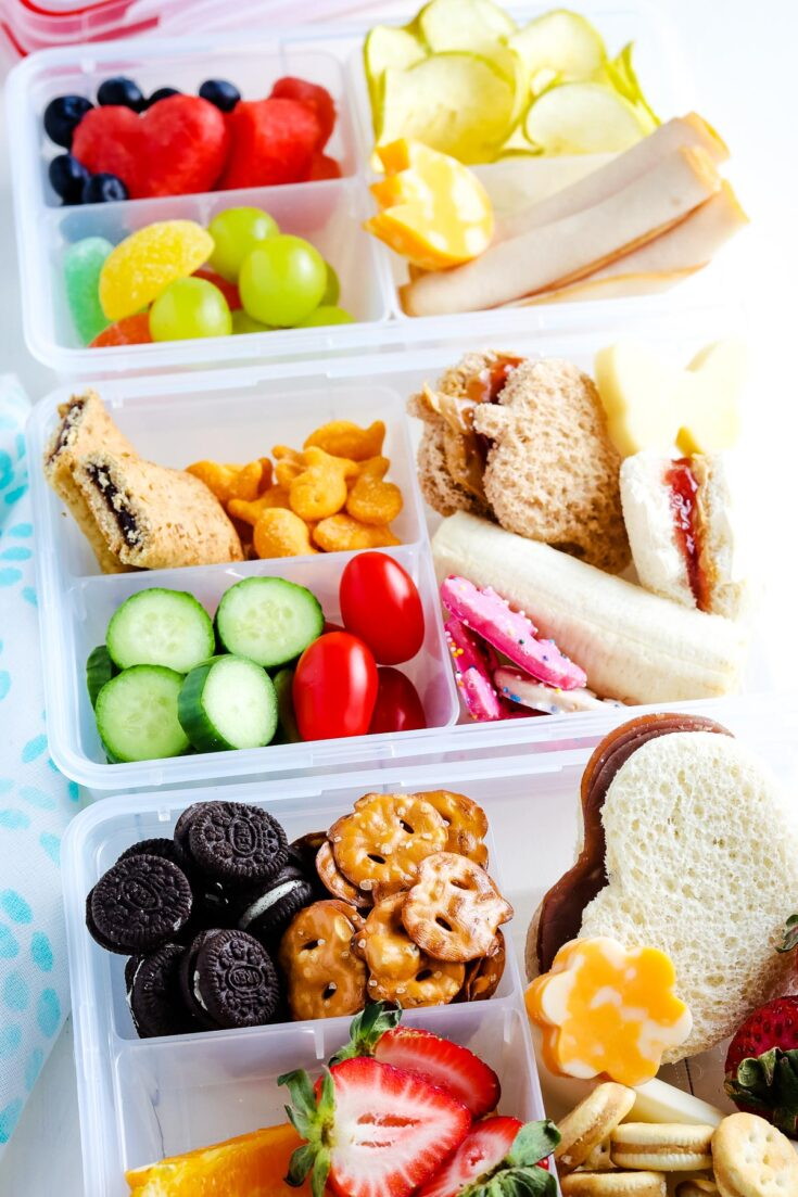 Overhead image of lunch boxes filled with options for kids