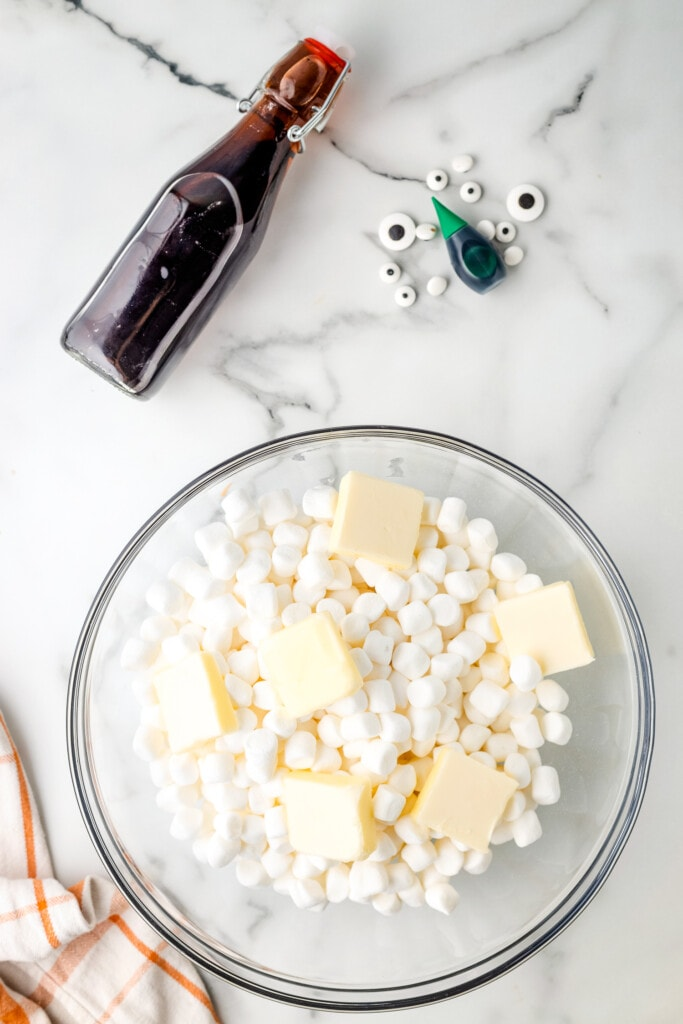 Glass bowl with mini marshmallows and slabs of butter