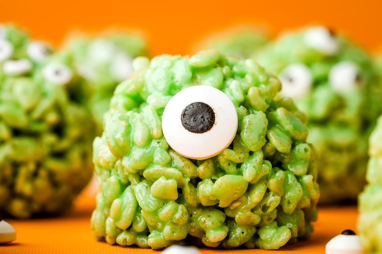 Monster Rice Krispie Treat with candy eye on orange background