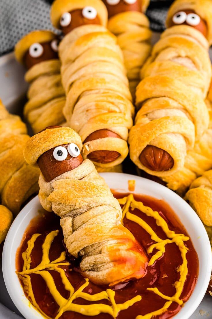 Mummy Hot Dog dipped in ketchup