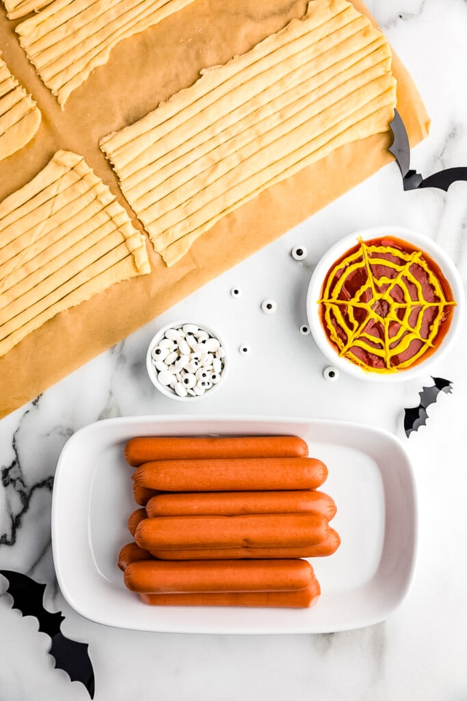 Mummy Hot Dog Ingredients with crescent rolls cut into strips