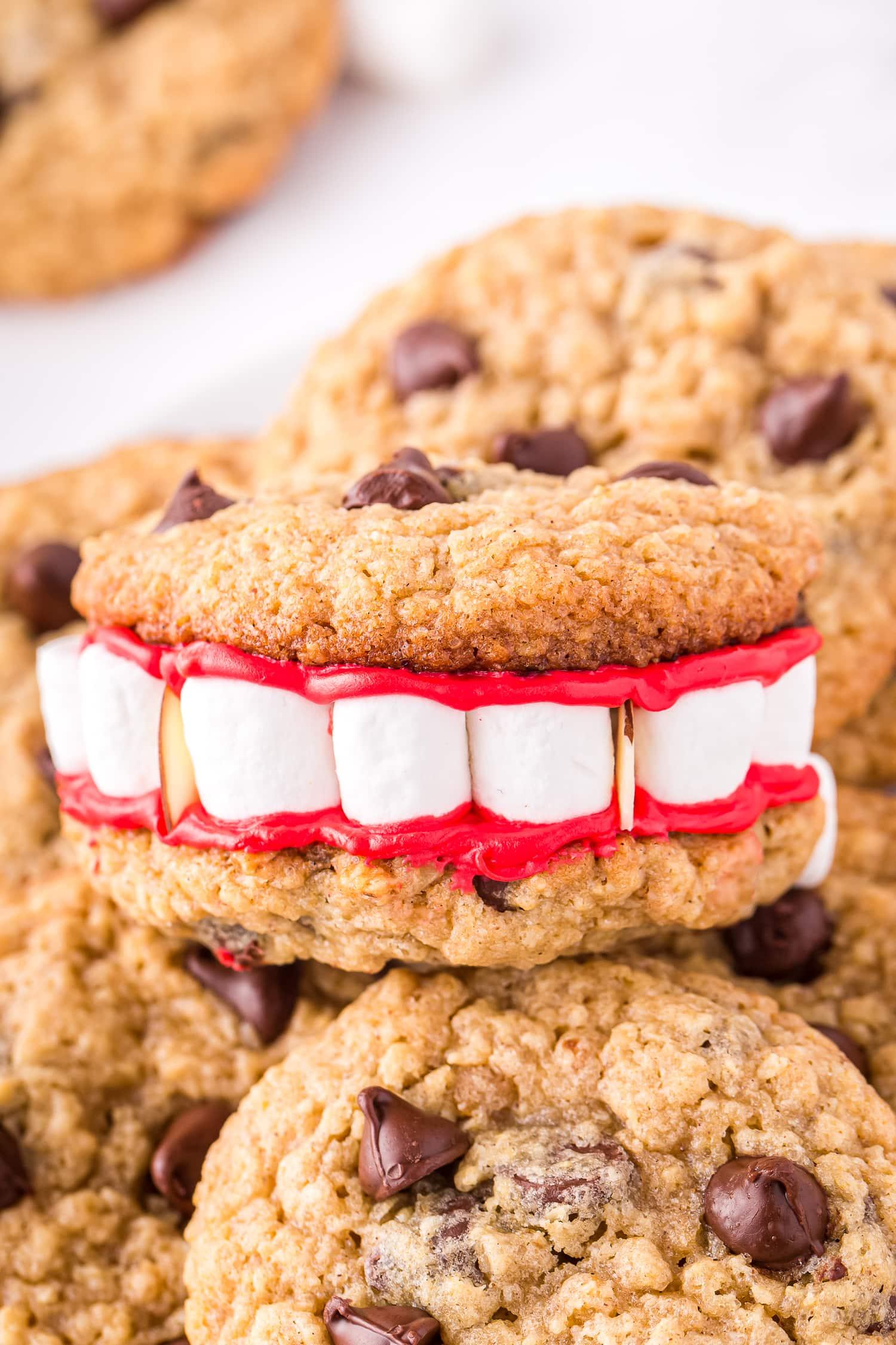 Dracula Denture cookie sitting on top of more